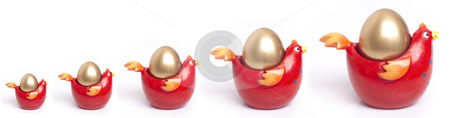 Golden egg growth chart stock photo, Growth concept represented by golden eggs in a graph format by Gary Cookson