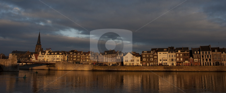 Maastricht Canal in Wide stock photo, A line of houses at the riverbank of Maas river at Maastricht, the Netherlands by SuiPhoto