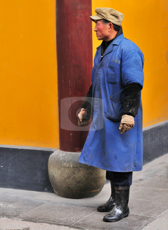 Chinese buddhist shrine  stock photo, Worker in Chinese buddhist shrine in the city of Shanghai China by Kobby Dagan