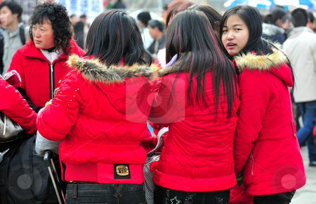 Chinese girls stock photo, Group of Chinese girls in crowded shanghai street by Kobby Dagan