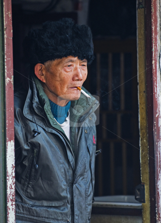 Old Chinese man stock photo, Portrait of old Chinese man in Shanghai China by Kobby Dagan