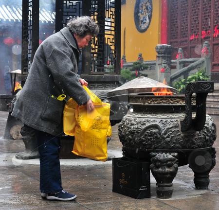 Chinese buddhist shrine  stock photo, Worshiper in Chinese buddhist shrine in the city of Shanghai China by Kobby Dagan