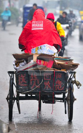 Chinese traffic stock photo, Tricycle in chinese traffic on shanghai street by Kobby Dagan