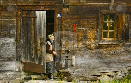 Old turkish woman stock photo, Old turkish woman near here house in east Turkey by Kobby Dagan