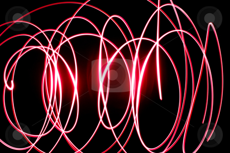 Abtract Light Background stock photo, An abstract light background showing motion blurred light on a dark background. by Travis Manley