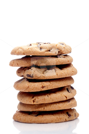 Vertical image of a stack of 7 chocolate chip cookies on a white stock photo, Vertical image of a stack of 7 chocolate chip cookies on a white reflective surface by Vince Clements