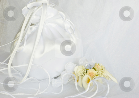 Wedding flowers and bridal bag over veil stock photo, Bridal bag wedding flowers decorations over bridal veil by Desislava Dimitrova