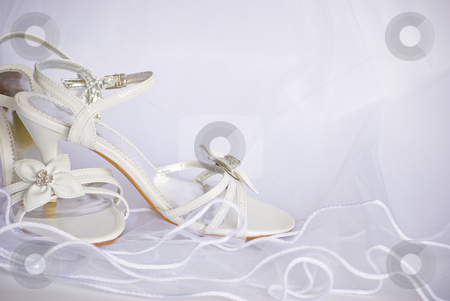 Wedding sandals and flowers over veil stock photo, Wedding sandals and flowers decoration over bridal veil by Desislava Dimitrova