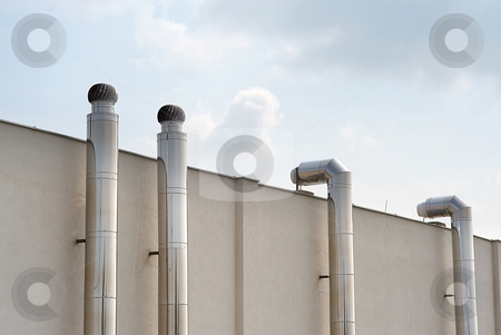 Air condition stock photo, Air condition metal pipes outside of a building with sky and clouds by Juraj Kovacik