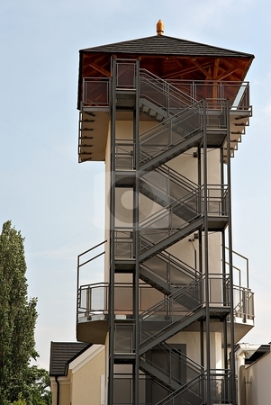 Staircases stock photo, Tower with metal outside staircases and wooden roof by Juraj Kovacik
