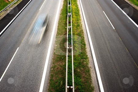 Highway stock photo, Highway detail with speeding blur car by Juraj Kovacik