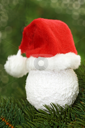 Santa claus cap stock photo, Christmas tree ball with santa claus cap  on green background by Birgit Reitz-Hofmann