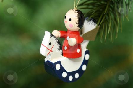 Chrismas angel stock photo, Christmas tree decoration on red background by Birgit Reitz-Hofmann