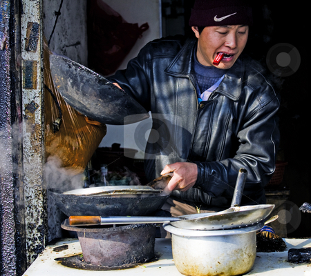 Chinese cook stock photo, Chinese cook  in shanghai china by Kobby Dagan