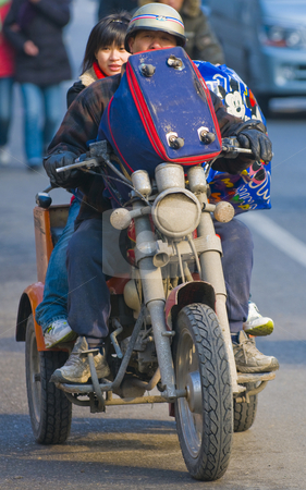 Chinese motorcyclist  stock photo, Chinese motorcyclist in shanghai street by Kobby Dagan