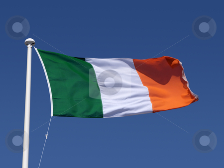 The Irish tricolour flag and blue sky. stock photo, The Irish tricolour flag and blue sky. by Stephen Rees
