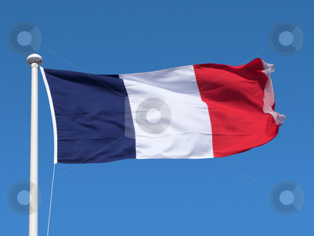 French flag blowing in the wind in a blue sky. stock photo, French flag (drapeau tricolore) blowing in the wind in a blue sky. by Stephen Rees