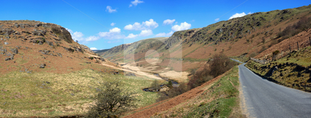 Panoramic narrow country road through the hills to Tregaron in Wales, UK. stock photo, Panoramic narrow country road through the hills to Tregaron in Wales, UK. by Stephen Rees