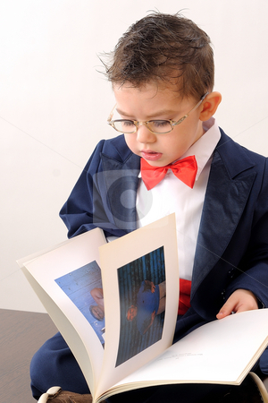 Elegant boy stock photo, Educated boy looking in book by Dragos Iliescu