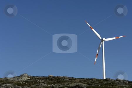 Turbine stock photo, White wind turbine in the top of the mountain by Rui Vale de Sousa