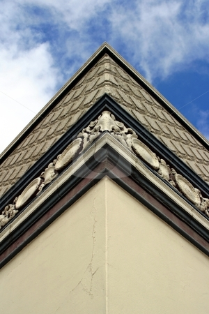 Corner Of Building stock photo, Corner of a building with the sky and clouds in the background. by Henrik Lehnerer