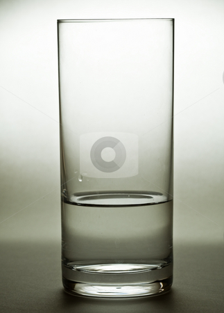 Glass of water stock photo, A half filled glass of water againt a plain background by Damir Franusic