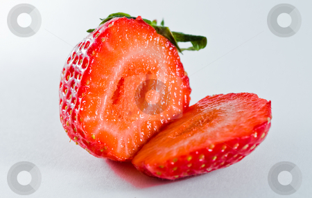 Two strawberries stock photo, Juicy strawberry fruit split in two pieces by Damir Franusic