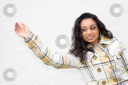 Hailing a Taxi Cab stock photo, A portrait of an attractive young Indian woman waving to some friends or even hailing a taxi cab. by Todd Arena
