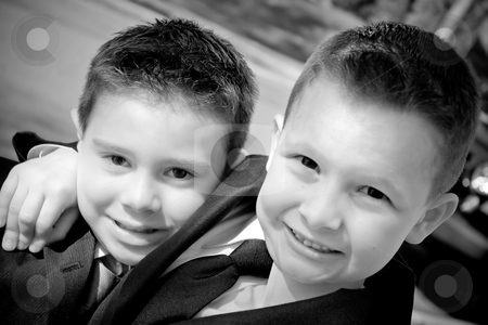 Two Happy Young Boys stock photo, Two happy young boys dressed in suits with smiles on their faces.  Black and white. by Todd Arena