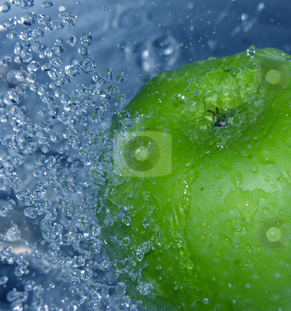Apple in water stock photo,  by Kirsty Pargeter