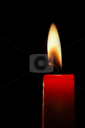 Red candle stock photo, Burning red candle on black background by Gjermund Alsos