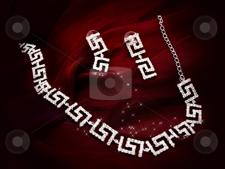 Necklace earrings at red fabric stock photo, Shiny necklace and earrings at red fabric by Sergej Razvodovskij