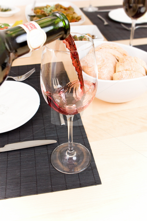 Serving wine stock photo, Filling an empty glass with wine by Jan Martin Will