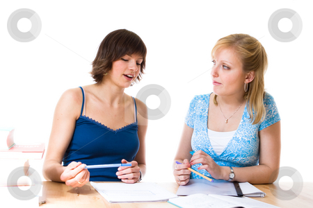Team work stock photo, Two young women helping each other out in their studies by Jan Martin Will