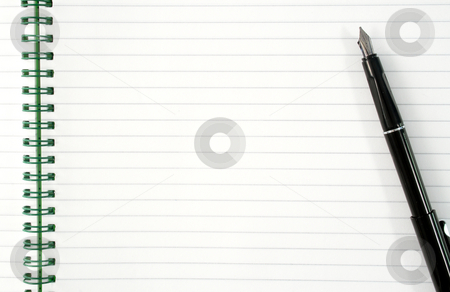 An open spiral notepad with blank lined paper and a black pen. stock photo, An open spiral notepad with blank lined paper and a black fountain pen. by Stephen Rees