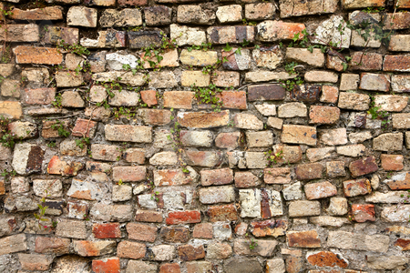 A mixed stone and bricks colorful wall. stock photo, A mixed stone and bricks colorful wall. by Stephen Rees