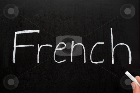 French, written with white chalk on a blackboard. stock photo, French, written with white chalk on a blackboard. by Stephen Rees