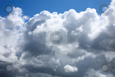 Stormy rain clouds forming in a blue sky. stock photo, Stormy rain clouds forming in a blue sky. by Stephen Rees