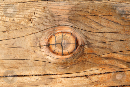 A wood knot in a wooden beam.  Looks like a wooden eye. stock photo, A wood knot in a wooden beam.  Looks like a wooden eye. by Stephen Rees