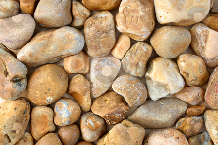 Natural brown beach stones. stock photo, Natural brown beach stones. by Stephen Rees