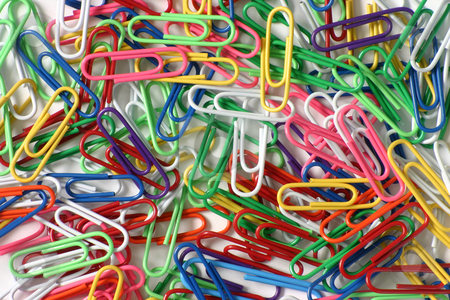Color paperclips on a white background stock photo, Color paperclips on a white background by Stephen Rees