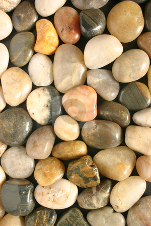 Colorful polished pebbles vertical view stock photo, Colorful polished pebbles vertical view by Stephen Rees