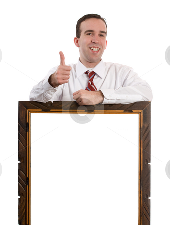 Success stock photo, Businessman giving a thumbs up while leaning on an empty frame for your text by Richard Nelson