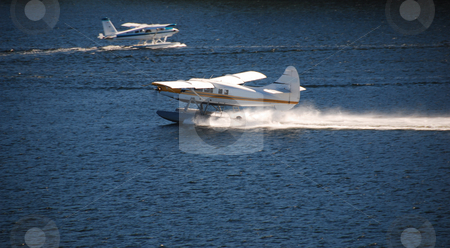 Floatplanes stock photo, Two floatplanes take off and landind at the same time by Wolfgang Zintl