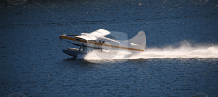 Float plane stock photo, Float plane takes of on the water by Wolfgang Zintl