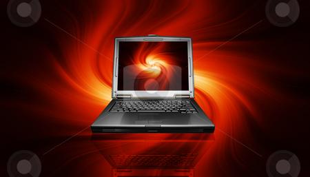 Laptop on fiery background stock photo, 3D render of a laptop on a fiery background by Kirsty Pargeter