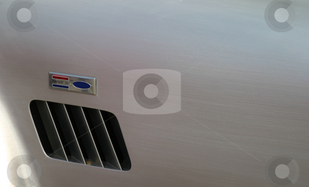 Powered By stock photo, Air vent on a car with brushed metal by Henrik Lehnerer
