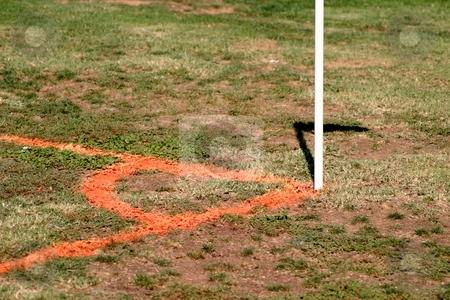 Orange Soccer Corner stock photo, Soccer corner with flag stick on a football field. by Henrik Lehnerer