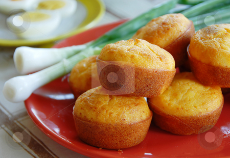 Appetizing bakery stock photo, Yellow bakery on red plate served on kitchen table by Julija Sapic