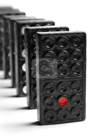Domino stock photo, Line of domino blocks isolated on white background by Gjermund Alsos